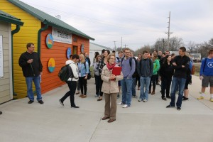 Drake University Professor of management Deb Bishop, center, brought 38 of her students to Perry on April 4 to view the town and get a first-hand feel for their assignment. Perry City Administrator Butch Niebuhr is at left.