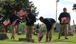"""We will check every spot -- we do not want to miss a single one. It is an honor to do this."" So said a Woodward Academy student Monday as he and six classmates placed flags on the graves of veterans at Violet Hill Cemetery."