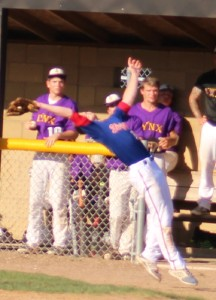 Will Whiton makes an acrobatic catch on a foul pop for the first out of the seventh inning.