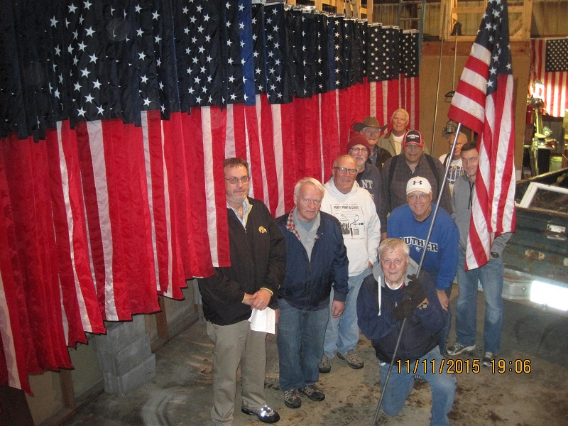 Among the flag raisers in the Flags over Perry program are Lions and Optimists, clockwise from left, Dave Wright, John Andorf, Rich Saemisch, Jim McCauley, Allen Becker, Gary Becker, Jim George, Lou Hoger, Cole Adair, Clark Wicks and Jack Shelker. Photo courtesy Lions Club Secretary Ray Harden