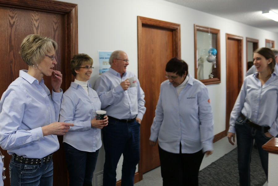Sharing a laugh at the Simplex Seed open house Thursday were, from left, Administrative Assistant Marlys Goudie, General Manager Mike Goudie, Accountant Renae Gasche, Accountant Mary Ann Youngbloom and Northwest Iowa District Sales Manager Trisha Kientz.