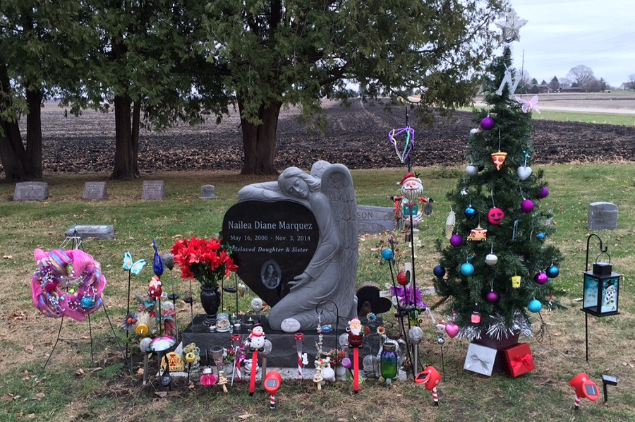 nailea marquezs grave in violet hill cemetery includes a solar powered christmas tree and a christmas stocking