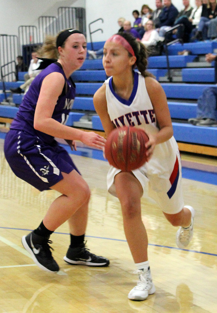 Mariah Duffy takes the ball along the baseline.