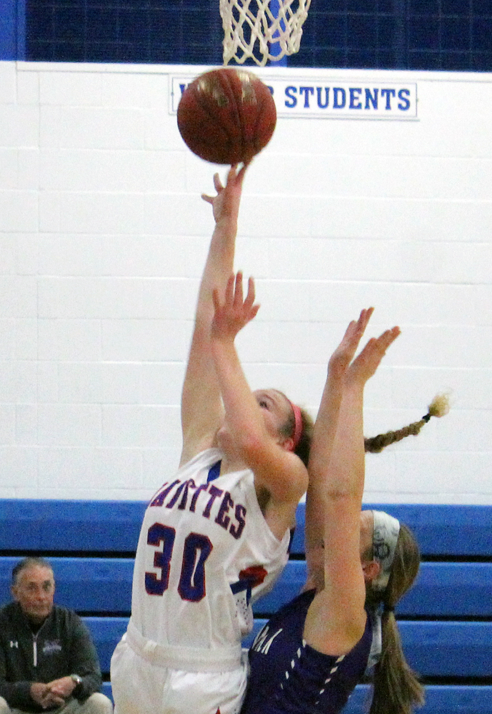 Grace Marburger scores on a layup off a Mariah Duffy assist in the second quarter.