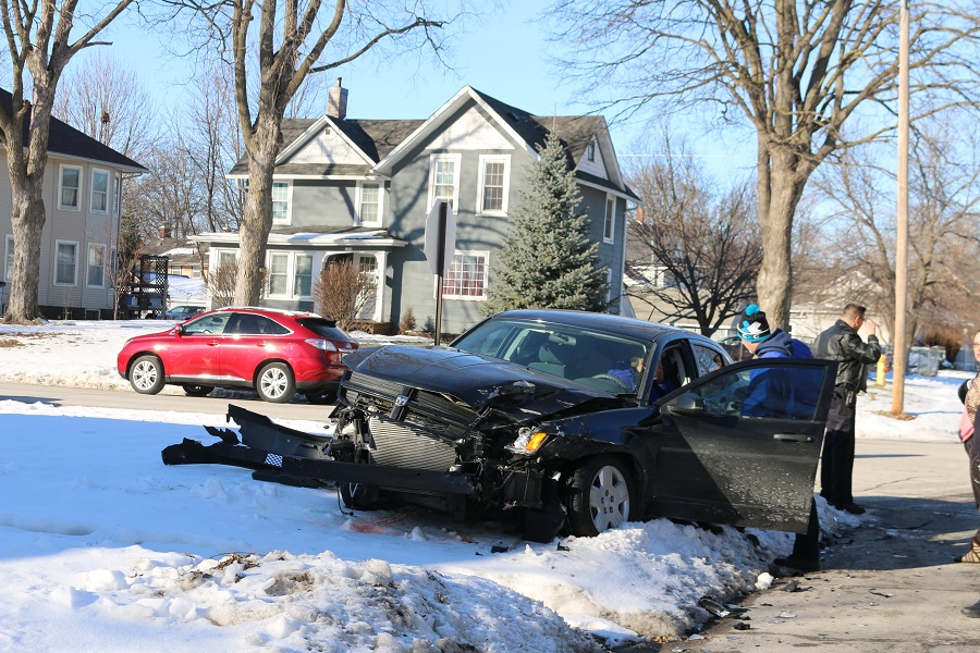 Perry First Responder attend the driver of a four-door car involved in a collision Wednesday afternoon at Eighth Street and Otley Avenue.