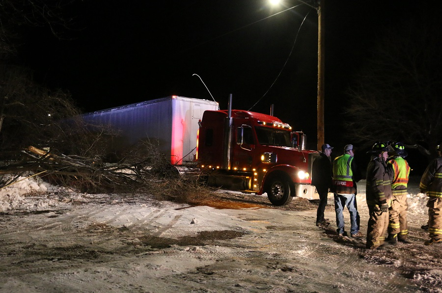 Emergency crews stood by Thursday night, awaiting the arrival of an Alliant Energy crew, after a semi-tractor trailer struck a power pole at W. 10th and Lucinda streets. and downed a power line. The vehicle appeared to be southbound on W. 10th Street.