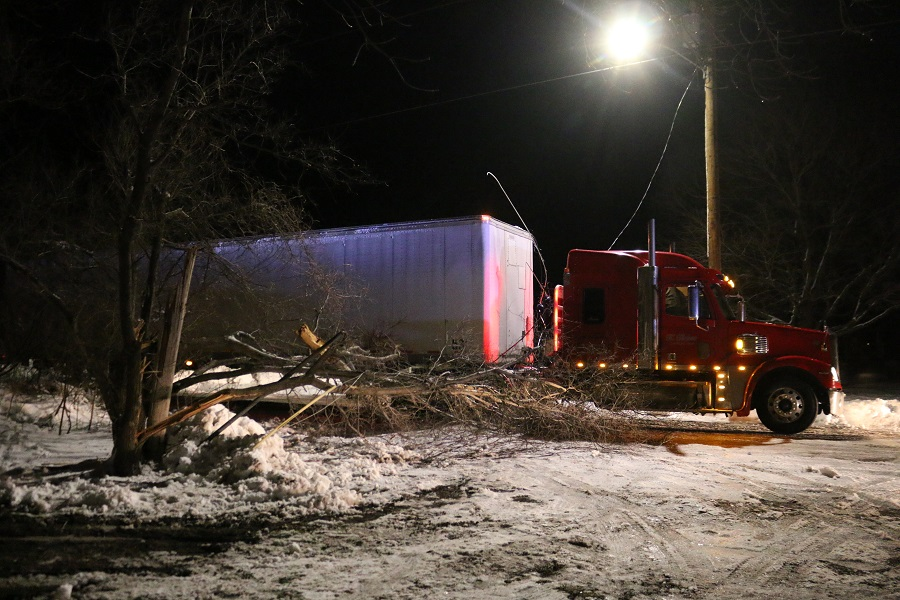 A semi-tractor trailer struck a power pole at W. 10th and Lucinda streets in Perry about 8 p.m. Thursday, clipping nearby trees and downing a power line. The vehicle appeared to be southbound on W. 10th Street.
