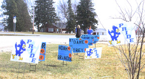 Signs supporting the Bluejays lined a section of east Willis Avenue this morning.