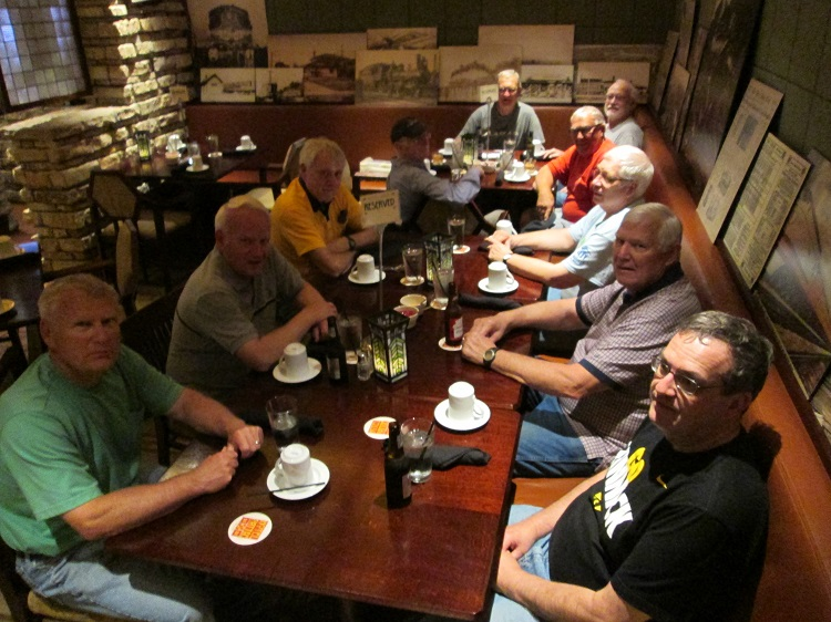 Enjoying the fruits of their Earth Day labor were Perry Lions, clockwise from left, Jim George, John Andorf, Jack Shelker, Andy Bambrick, Dwayne Hochhalter at the end. Harley McGuire, Richard Saemisch, Roger Niemeyer, Gary Becker and Dave Wright.