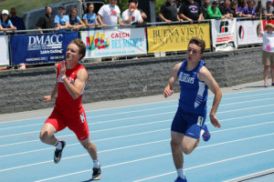 Perry's Reece Dunlap (right) races to make up the lag on Ballard's Noah Rosing in the 200 dash.