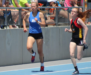 Perry junior Emma Olejniczak (left) battles Maddy Juhl of Iowa Falls-Alden as they come out of the final turn in the 400 at the state meet Thursday.