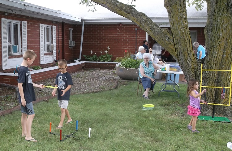 Children tossed rings and played hobo golf at the Perry Health Care Center's Fun Fest for All Friday. Every child who cast in the fish pond also received a prize.